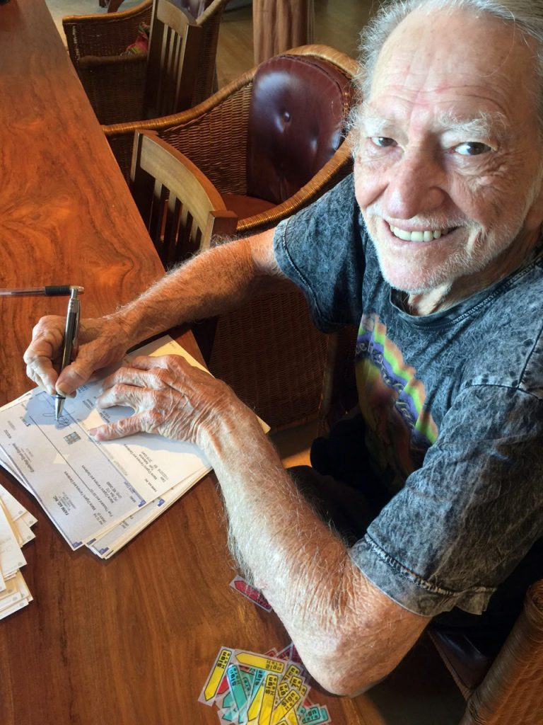 willie_nelson_signing_2016_grant_checks